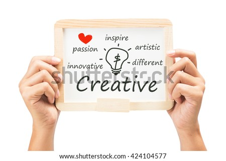 Hand show Creative topic concept with drawing light bulb on small whiteboard - stock photo