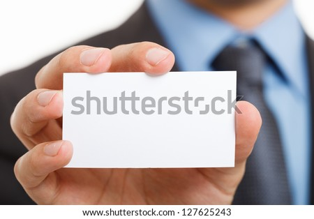 Hand showing a blank business card - stock photo
