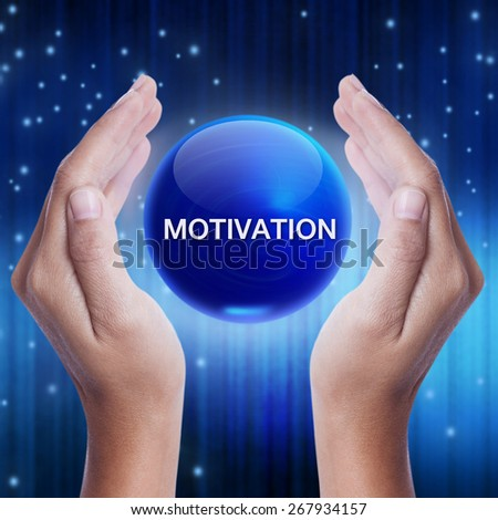 Hand showing blue crystal ball with motivation word. business concept - stock photo