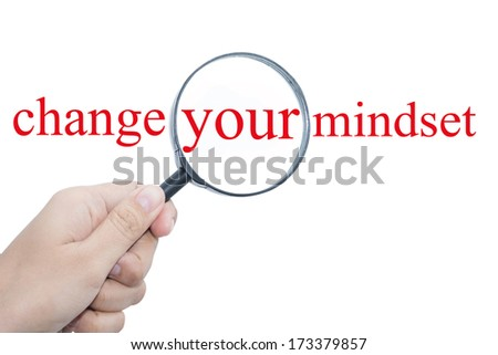 Hand Showing change your mindset Word Through Magnifying Glass   - stock photo