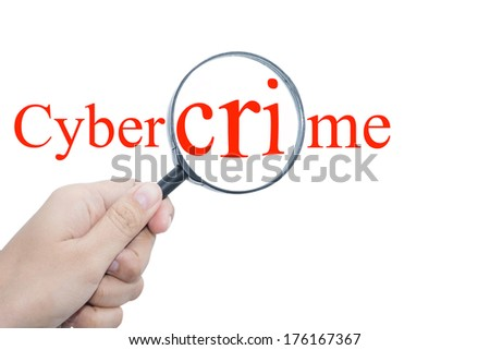 Hand Showing cyber crime Word Through Magnifying Glass  - stock photo