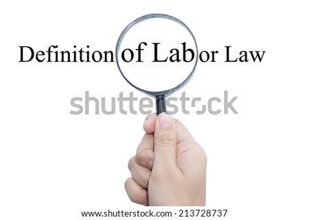 Hand Showing Definition of Labor Law Word Through Magnifying Glass  - stock photo