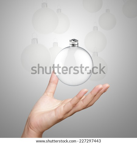 hand showing Empty Christmas ornament - stock photo