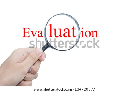 Hand Showing  Evaluation Word Through Magnifying Glass - stock photo