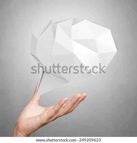 hand showing low poly geometric speech bubble on white background - stock photo