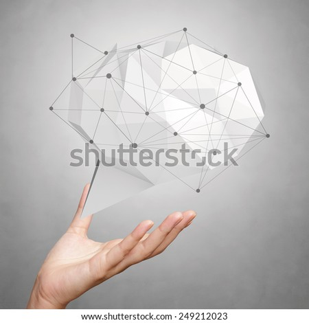 hand showing low poly geometric speech bubble with social media structure on white background - stock photo