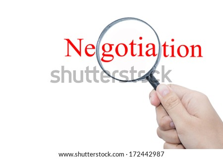 Hand Showing Negotiation Word Through Magnifying Glass  - stock photo
