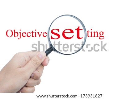 Hand Showing Objective setting Word Through Magnifying Glass  - stock photo