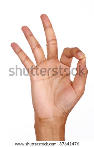Hand showing OK sign against white - stock photo