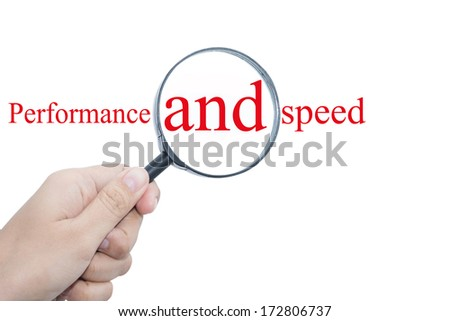 Hand Showing Performance and speed Word Through Magnifying Glass  - stock photo