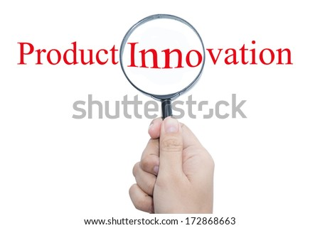 Hand Showing Product Innovation Word Through Magnifying Glass  - stock photo