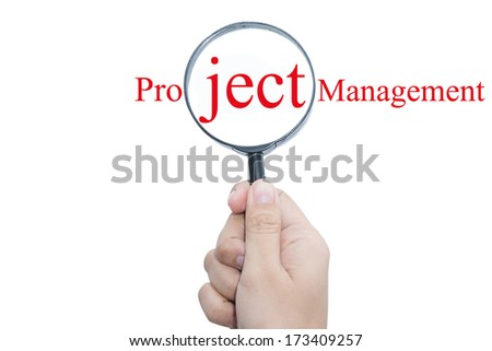 Hand Showing Project Management Word Through Magnifying Glass    - stock photo