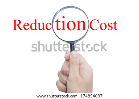 Hand Showing reduction cost Word Through Magnifying Glass  - stock photo