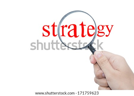 Hand Showing strategy Word Through Magnifying Glass  - stock photo