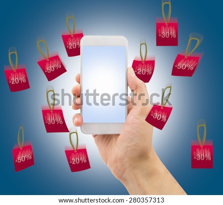 hand showing the smartphone with rain of falling prices - stock photo