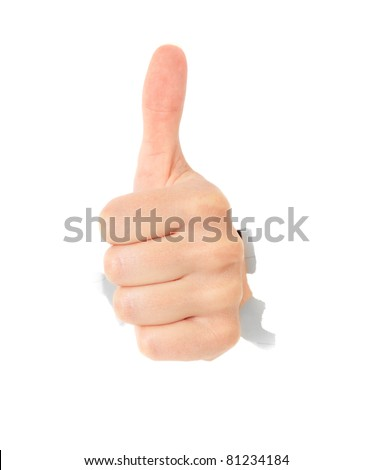 Hand showing thumbs up out of torn hole in white wall. All on white background. - stock photo