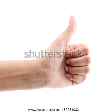 Hand showing thumbs up sign against white background  - stock photo