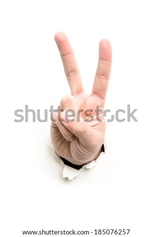 hand showing victory through the paper hole isolated on white background - stock photo