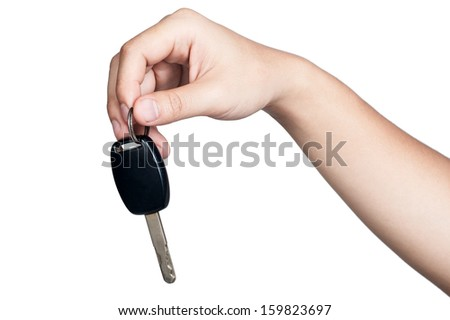 hand sign posture hold car key in isolated - stock photo