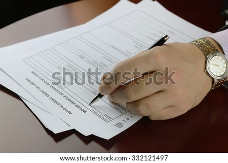 hand signature form car accident - stock photo