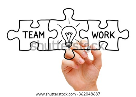 Hand sketching Teamwork Great Idea Puzzle Concept with black marker on transparent wipe board.  - stock photo