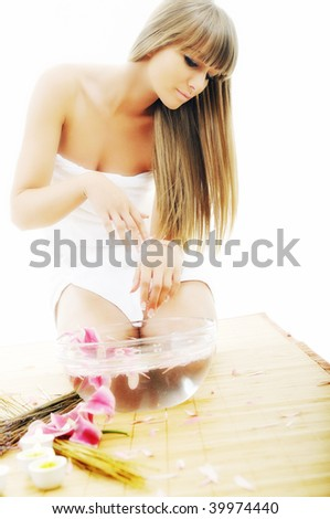 hand spa and beauty treatment with aroma and flowers in water - stock photo
