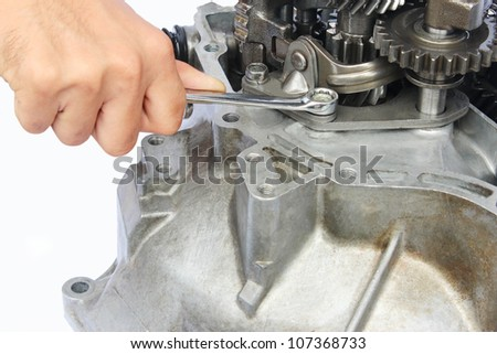 hand, spanner and gearbox repair - stock photo