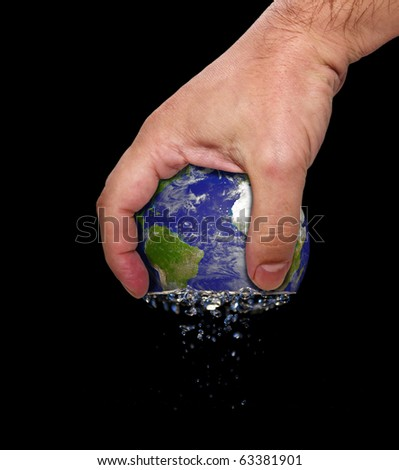 hand squeeze planet earth - stock photo