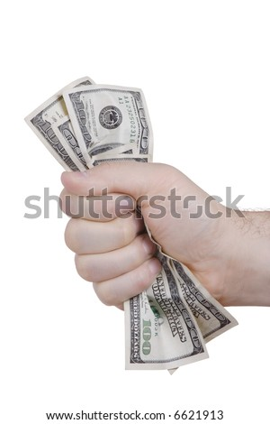Hand squeezing bunch of dollars against white background - stock photo