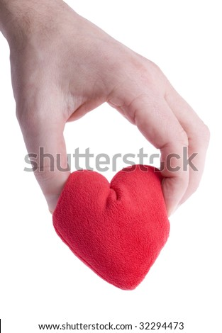 Hand squeezing heart tight, shot on white background - stock photo