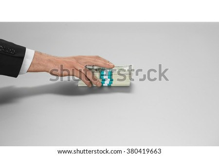 Hand taking cash. When nobody sees. Take what's yours. Passion of a lifetime. - stock photo