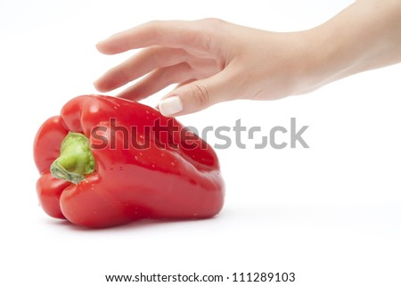 hand taking red pepper - stock photo