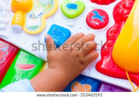 Hand the baby play toys - stock photo