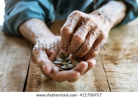 Hand the old man and pile coin for saving. money saving concept.over effect  - stock photo