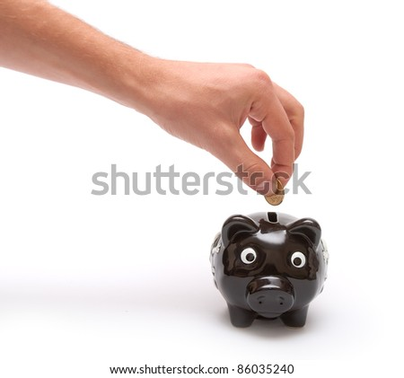 Hand thorows coin in piggy moneybox - stock photo