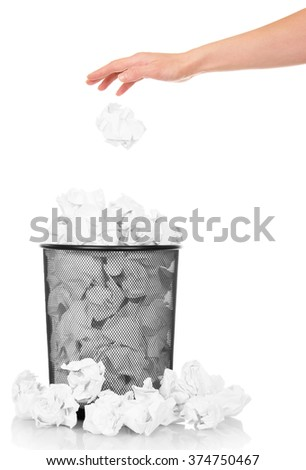 Hand throwing crumpled paper into the office trash isolated on white background - stock photo
