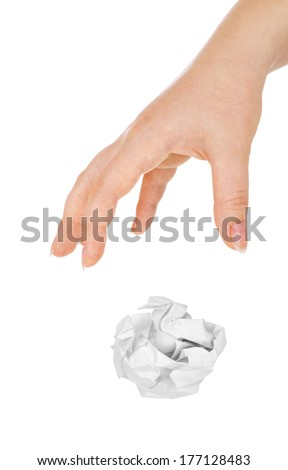 Hand throwing crumpled paper, isolated on white - stock photo