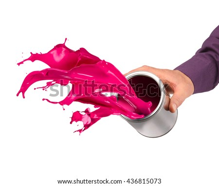 Hand throwing red pink paint from tin can isolated on white - stock photo