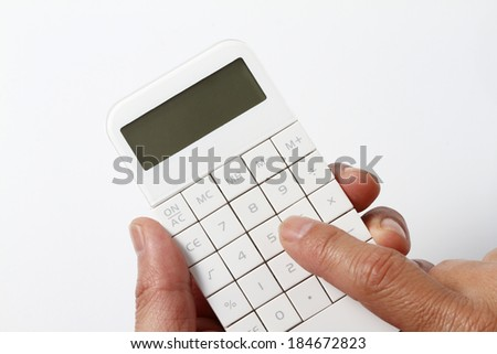 Hand to calculate - stock photo