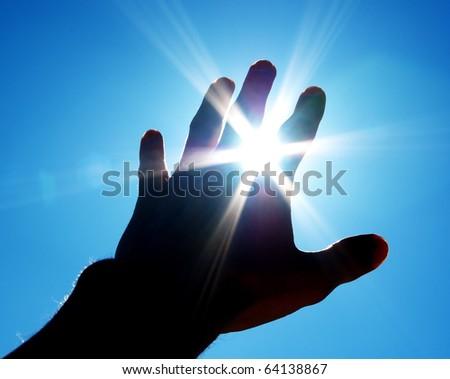 Hand to sun. Element of design. - stock photo