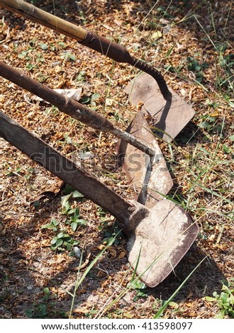 hand tools set for agricultural garden work made of metal steel and long wooden grips old and rustic leaving outdoor ready to use - stock photo
