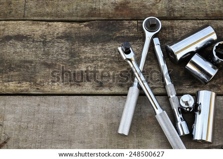 Hand tools set on wooden background. Hand tools with vintage picture style. - stock photo