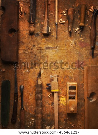 Hand tools Wood (Drill Jig Saw plane chisel) on an old wooden workbench - stock photo