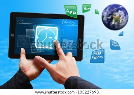 Hand touch on Clock icon on touch pad : Elements of this image furnished by NASA - stock photo