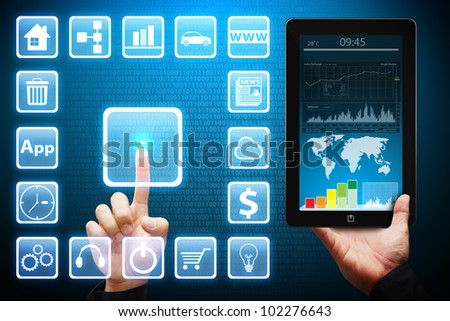 Hand touch on icon and tablet pc - stock photo