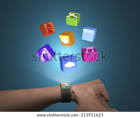 hand touch ultra-thin smart watch with apps and blue background - stock photo