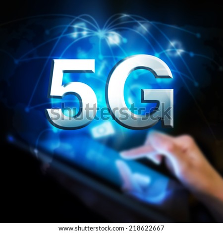 Hand touching digital tablet, global 5G network concept. - stock photo
