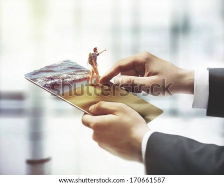 hand touching digital tablet, holiday concept  - stock photo