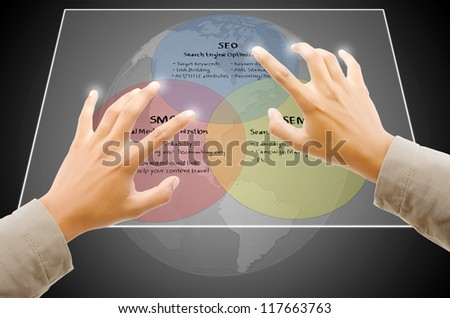 Hand touching SEO process on the Touchscreen Interface. - stock photo