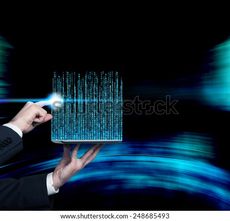 hand touching  touch pad with matrix code - stock photo